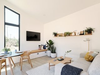 Owners can opt for a furnished home with built-ins like the bench seat pictured under the window. The design is highly customizable for a bespoke home.