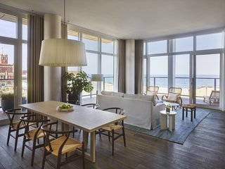 Suites include a spacious living and dining area, a full second bathroom, and a small, fully accessorized kitchen.
