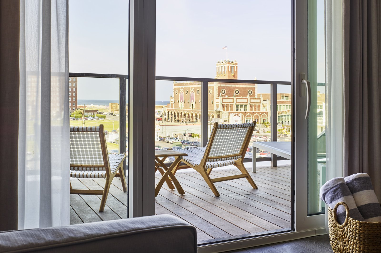 Outdoor, Small Patio, Porch, Deck, and Wood Patio, Porch, Deck Ocean-facing rooms look out on area landmarks like the Asbury Park Convention Hall, built in 1930.  Asbury Ocean Club Hotel from A New Five-Star Hotel Gives the Jersey Shore an Upgrade