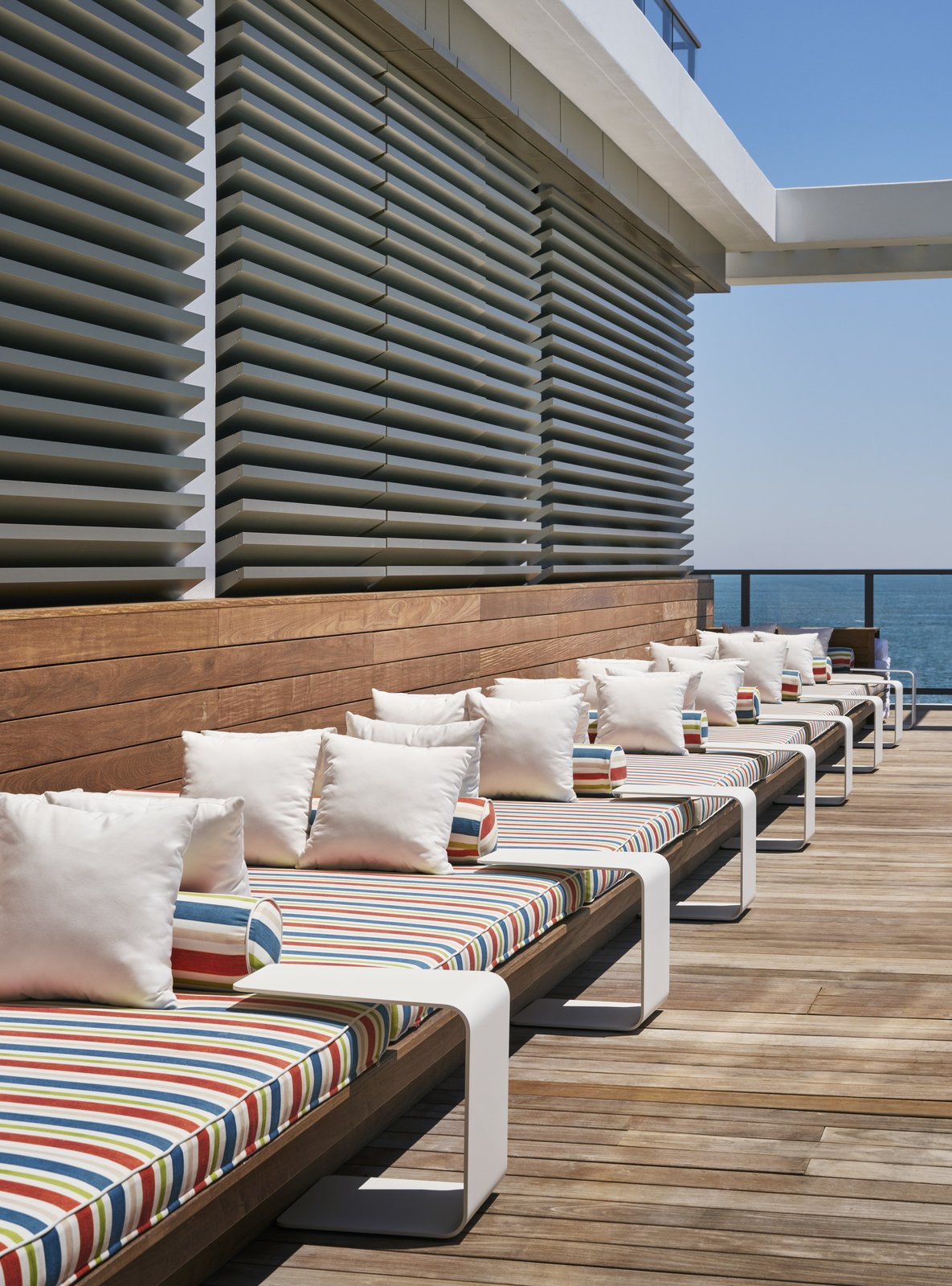 Outdoor, Large Patio, Porch, Deck, and Wood Patio, Porch, Deck A 55-foot nautical-themed sofa runs along one side of the pool deck.  Asbury Ocean Club Hotel from A New Five-Star Hotel Gives the Jersey Shore an Upgrade