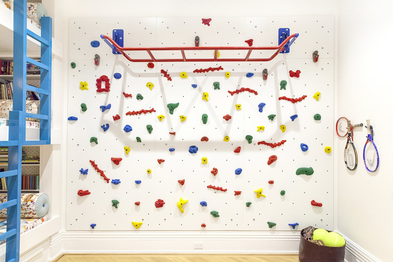 Kids, Playroom, Neutral, Bed, Toddler, and Light Hardwood A climbing wall and monkey bars ensure that the kids have plenty of space to goof off.  Kids Light Hardwood Bed Photos from A 19th-Century Apartment in Manhattan Gets a Kid-Friendly Upgrade