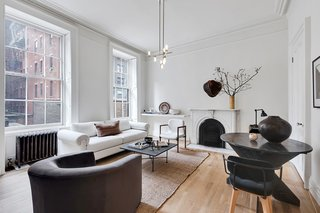 Masterfully styled by acclaimed interior designers Nate Berkus and Jeremiah Brent, this one-bedroom apartment is located in a classic 19th-century brownstone and blends historic architecture with chic, contemporary design.