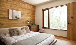 Rich wood paneling continues throughout the home, including all of the bedrooms.