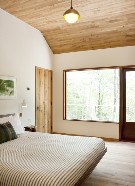 Here, a look at another one of the home's three bedrooms. This one offers direct access to the wrap-around deck.