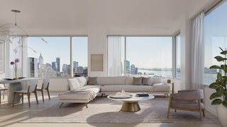 """Expansive windows are a central feature of all units in the building. """"Corner windows were important. There's a rhythm to it—from here, you can see the Hudson River; from there, you can see Central Park,"""" says Siza."""
