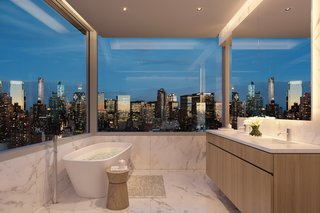 """The penthouse's master bathroom looks out over unobstructed views. """"In all the residences, maximizing far-reaching views of Midtown, Downtown, and the Hudson River was a top priority,"""" says Siza."""