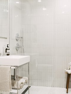 The tranquil bathroom pairs two types of tile with similar tones.