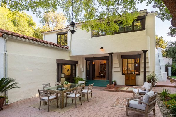 In addition to the spacious dining patio, the home also includes a lush, grassy yard—a rare find in the area due to the canyon's hilly terrain.