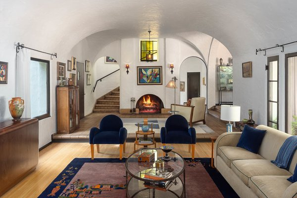 Another view of the home's extensive vaulted ceilings. An archway houses the main staircase, which leads to the second level and is gracefully lit by original stained glass.