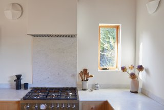 Marble countertops run over the wood cabinetry.