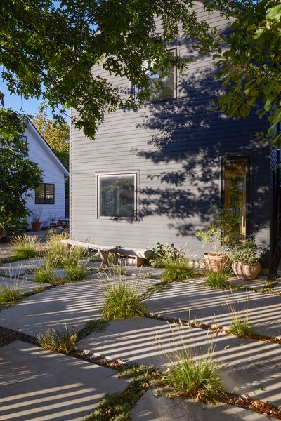San Francisco–based landscape design studio TALC helped reimagine the lot and the green spaces around the two buildings, with distinct exterior rooms: a meadow, a dining area, a fire pit area, and a patio.