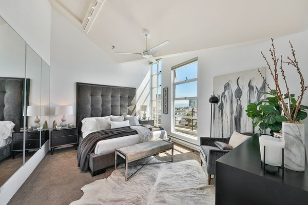 In total, the penthouse includes two bedrooms, both of which are bright, airy, and spacious.  Photo 7 of 9 in Get the Upper Hand on Time in This Rare Clocktower Penthouse, Listed For $6M