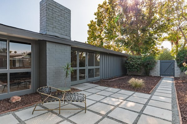 Set on a 5,556-square foot lot, the majority of the home is tucked behind a cinderblock wall facing the street. Mature Sycamore trees surrounding the property provide ample shading, allowing the landscaped outdoor areas to be enjoyed even on the warmest of days.