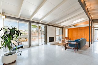 Walls of windows usher in an abundance of light throughout the home's spacious, open layout.
