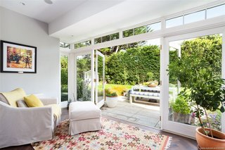 Large French doors open up to the backyard from a reading nook on the first floor. The bright, cozy corner flows onto a granite patio for easy al fresco dining.