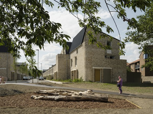 Throughout the development, pocket parks add green space and wide pathways prioritize pedestrian safety.   Photo 3 of 6 in An Eco-Friendly Affordable Housing Project Just Won the RIBA Stirling Prize