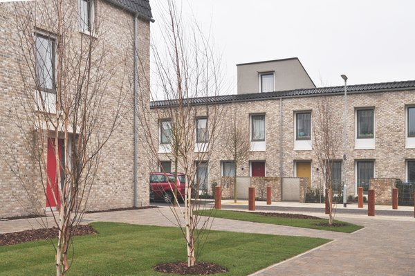 Passive solar design cuts energy costs by an estimated 70% per household.  Photo 5 of 6 in An Eco-Friendly Affordable Housing Project Just Won the RIBA Stirling Prize