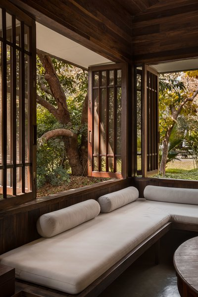 Nestled in a mango grove, Studio Mumbai's Chondi residence bridges two opposing desires: a wish to bring nature indoors and, yet, to be sheltered from it. Its thin wooden walls welcome the encroaching landscape, light, and visitors inside. At the center of the house, a secret courtyard contains a space for living.