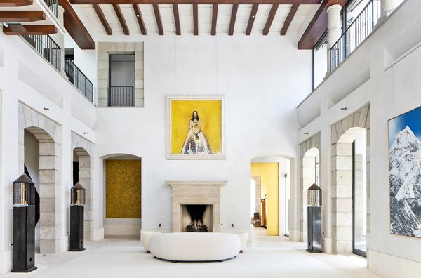 The entryway leads to a voluminous central atrium with 30-foot-tall ceilings and 400-year-old moorish columns along the upper gallery areas.