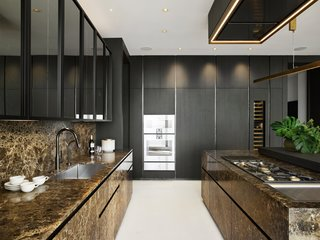 The large space also features Gaggenau appliances, including a built-in refrigerator, double ovens, and five-burner cooktop.