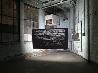 Light artist Patrick Ethen's exhibition <i>Field Condition</i> displayed several of his ethereal pieces, each purposefully hung away from the wall to expose their intricate wiring. <i>Rising Tides</i>, shown above, translates the rippled surface of water into white LED lights.