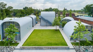 """Prince Concepts tapped EC3 to build True North, a live/work community of prefabricated Quonset huts, each oriented to maximize daylight and framed communal outdoor spaces. """"I wanted to give people affordable, but also inspired, space,"""" says Kafka."""