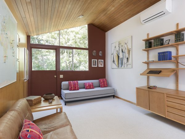 A spacious home office, which can easily be converted depending on the buyer's needs, offers direct access to the outdoors. Large, angled windows invite plenty of light inside.