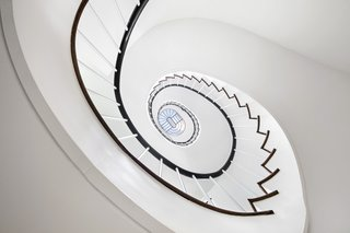 A peek at the stunning Pei-designed spiral staircase, capped with an oblong skylight.