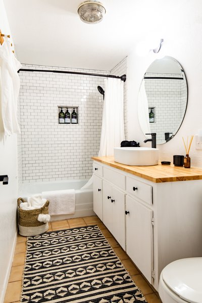 Like the rest of the home, the bathrooms have been completely remodeled and feature all-new fixtures and finishes. Wide subway tiles climb all the way up the wall in the shower.