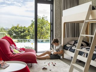 The ground floor, which holds the children's bedrooms as well as a den and gym, opens to the pool terrace.