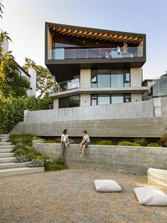 """The steeply sloping site provides three unique spaces—the living attic, the pool deck, and the garden terrace."""