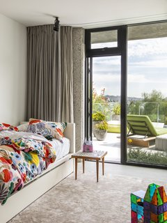 In a child's room, Marimekko fabric covers a West Elm daybed.