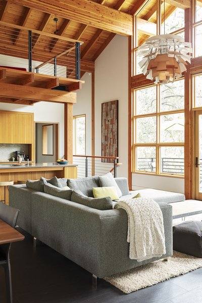 Architect couple Sherry Scott and John Kosich spent eight years building this vacation home in Truckee, California, complete with snow-friendly concrete and stone terraces. The star of the wood-dominated living room is the PH Artichoke pendant, designed by Poul Henningsen and manufactured by Louis Poulsen.