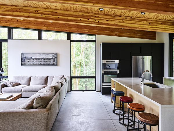 Flooded with natural light through picture and clerestory windows from the E-Series by Andersen, the open living area is where the cabin feels most like a tree house.
