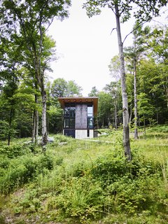 Just outside Stowe, Vermont, the Barr family cabin, designed by architect Tom Kundig, sits on a hillside overlooking a dense landscape of maples, Scotch pines, and ferns. Kundig wrapped two of the cabin's three stories in Cor-Ten steel, a signature material for the designer.