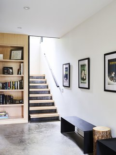The staircase in the mudroom is made of raw steel kickplates and treads created from locally harvested sugar maples.