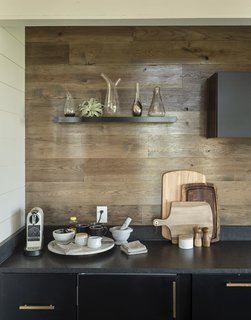 Hickory planks form the kitchen backsplash and are used as flooring throughout.
