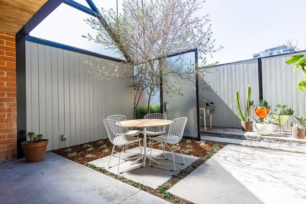 Concrete flooring continues out into the courtyard, creating a more seamless flow between inside and out.