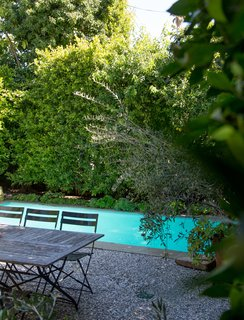 Set on a 6,456-square-foot lot, the home also includes an intimate backyard pool. Thick hedges surround the space, creating an idyllic city escape.