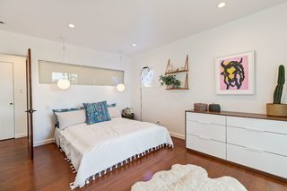A peek into the spacious second bedroom, which also opens up to the surrounding canyons via large windows along the opposite wall.