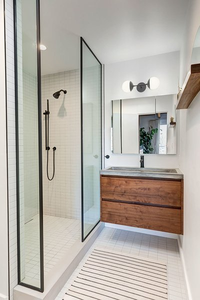 In addition to a custom walnut vanity, the second bathroom also features a stand-alone shower finished in Italian tile.