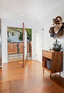 After purchasing the dwelling in 2006, Emmy-nominated actor Jason Thompson meticulously modernized the midcentury home, adding striking updates throughout. One example is the home's pivoting front door.