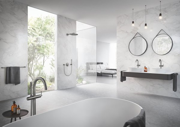 """""""Are you the type of person that enjoys a long soak to  relax after the day? In that case, it could make sense to integrate a beautiful free-standing  tub with floor mounted tub filler as an important feature in the bath,"""" advises Amy Hill, interior designer and manager at GROHE."""