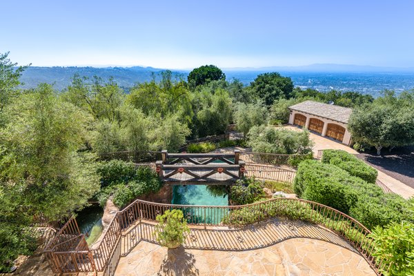 Sweeping views of the pool, property, and city beyond can be enjoyed from the villa terraces.