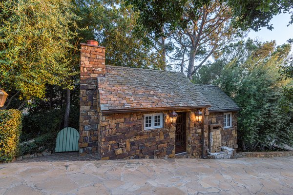 Neatly nestled along the driveway is smaller stone cottage, which can easily serve as a studio space or guesthouse.