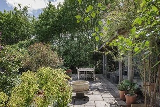 The landscaped property features several lush gardens and paved dining areas. Hidden behind mature beech hedging, this outdoor area offers a sheltered loggia for al-fresco dining.