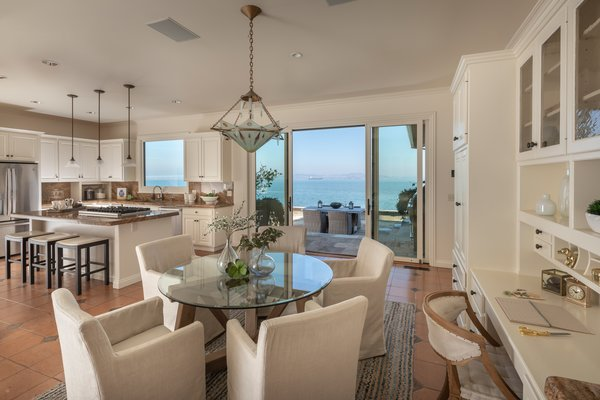 A cozy eating area sits adjacent to the kitchen. Sliding doors lead to the back patio.