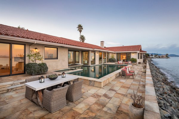 Steps away from the water, the back patio provides an incredible setting for entertaining.
