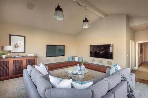A plush sectional offers plentiful seating in the cozy family room area.