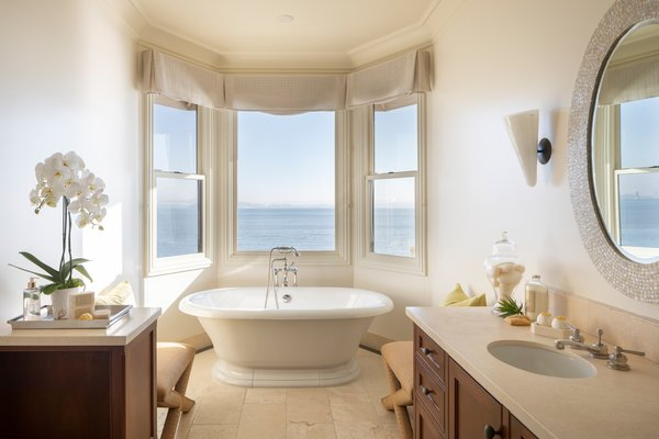 In one of the six full baths, a large soaking tub in nestled into an appropriately named bay window.